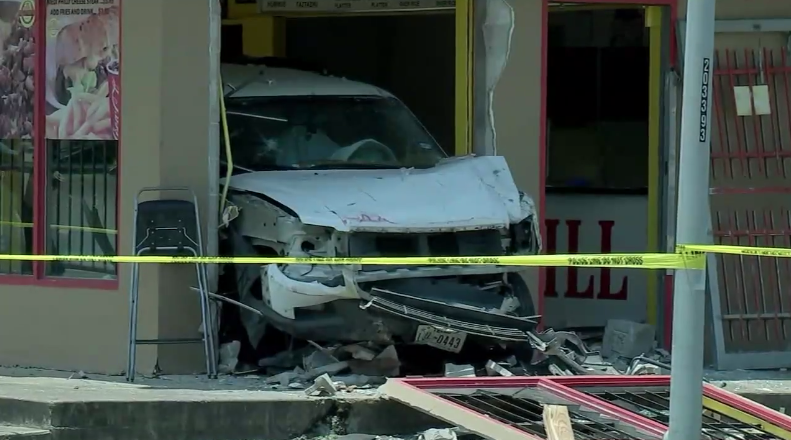 houston car accident crash into restaurant